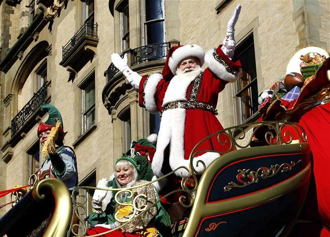 Santa Claus waves as he rides on his float down Central Park West during the 87th Macy's Thanksgiving Day Parade in New York November 28, 2013. REUTERS/Gary Hershorn