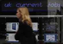 A pedestrian walks past an employment centre in London August 17, 2011. REUTERS/Suzanne Plunkett