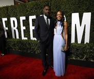 "Cast members Idris Elba and Naomie Harris pose at the premiere of ""Mandela: Long Walk to Freedom"" in Los Angeles, California November 11, 2013. REUTERS/Mario Anzuoni"
