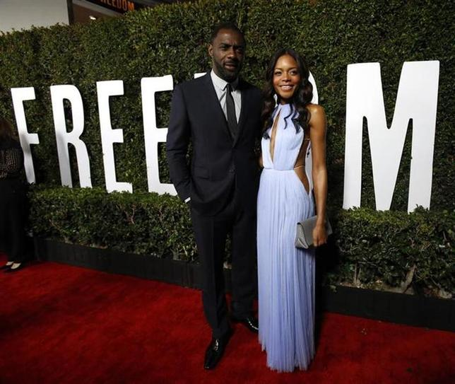 Cast members Idris Elba and Naomie Harris pose at the premiere of ''Mandela: Long Walk to Freedom'' in Los Angeles, California November 11, 2013. REUTERS/Mario Anzuoni