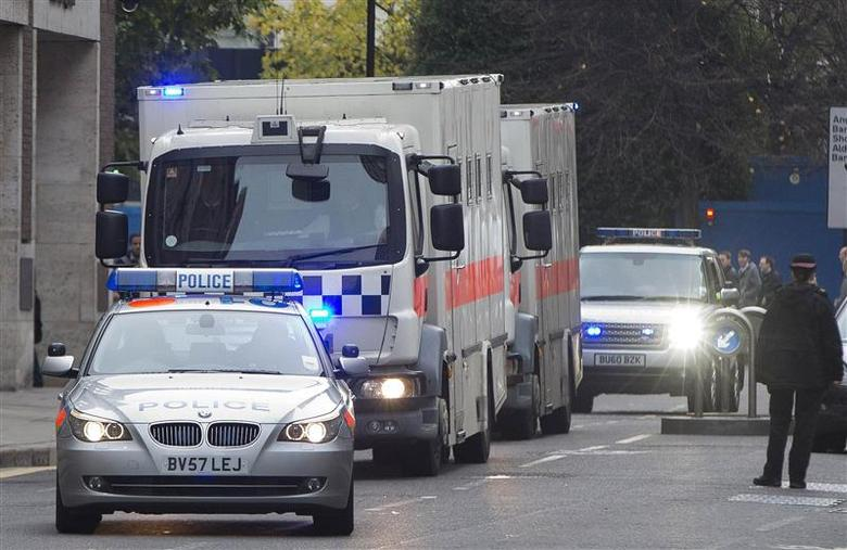 A police convoy of prison vans arrives at the Old Bailey, in London November 29, 2013. REUTERS/Neil Hall