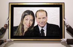 """Quadro chiamato """"Silvio e Ruby"""" fatto con buste di plastica e scotch esposto alla galleria Edward Cutler di Milano, 6 aprile 2011. REUTERS/Alessandro Garofalo"""