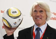"""Jiri Dvorak, Chief Medical Officer of the FIFA poses for photographers as he presents a ball with the lettering """"SAY NO! TO DOPING"""" during a news conference at the training camp of Switzerland's national soccer team in Crans Montana May 29, 2010. REUTERS/Michael Buholzer"""