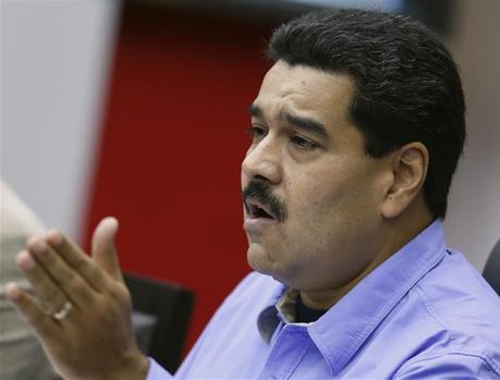 Venezuela's President Nicolas Maduro talks during a Council of Ministers meeting at Miraflores Palace in Caracas November 29, 2013. REUTERS/Carlos Garcia Rawlins