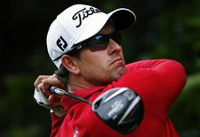 Australia's Adam Scott hits a drive on the second hole during the second round of the Australian Open golf tournament at Royal Sydney Golf Club November 29, 2013. REUTERS/David Gray