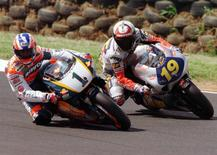 Australia's Michael Doohan (L) leads competitor Doriano Romboni of Italy into a corner during Free Practice for the 500cc Australian Motorcycle Grand Prix at Phillip Island October 3, 1997.