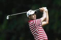Gaganjeet Bhullar of India watches his shot on the first hole during the Malaysia's Asia Pacific Classic golf tournament in Kuala Lumpur October 25, 2012. REUTERS/Bazuki Muhammad