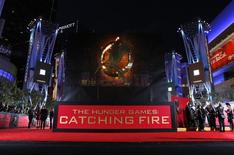 "People wait at the premiere of ""The Hunger Games: Catching Fire"" in Los Angeles, California November 18, 2013. REUTERS/Mario Anzuoni"