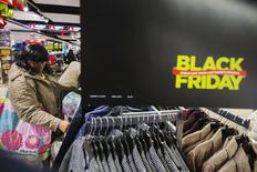 A shopper looks at items on sale inside of a JC Penney store during Black Friday sales in New York, November 29, 2013. REUTERS/Lucas Jackson