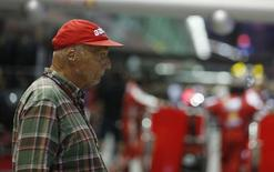 Former Formula One racing driver and three-time F1 World Champion, Niki Lauda of Austria, stands in the pit lane before the start of the Singapore Formula One Grand Prix September 22, 2013. REUTERS/Pablo Sanchez
