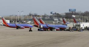 Several Souhtwest Airlines planes are lined up at Terminal two at the Lambert - St. Louis International Airport, in St. Louis, Missouri, March 4, 2013. REUTERS/Tom Gannam