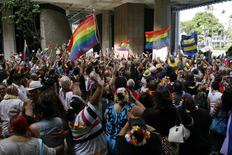 Supporters of same-sex marriage celebrate after the Hawaii State Senate approved a bill allowing same-sex marriage to be legal in the state of Hawaii, in Honolulu November 12, 2013. REUTERS/Hugh Gentry
