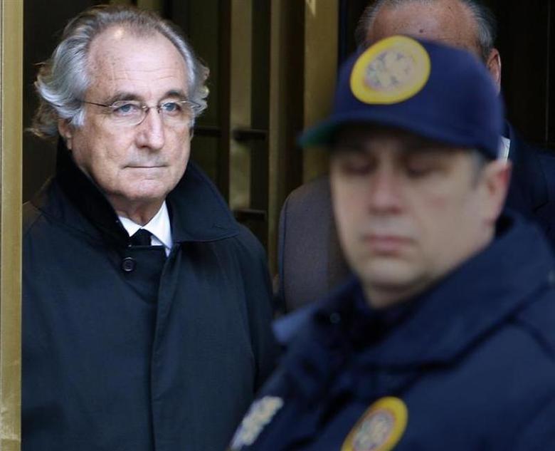 Accused swindler Bernard Madoff exits the Manhattan federal court house in New York January 14, 2009. REUTERS/Brendan McDermid