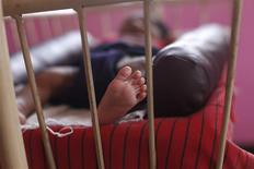 A baby girl is seen lying in a cradle inside the Life Line Trust orphanage in Salem in the southern Indian state of Tamil Nadu June 20, 2013. Thomson Reuters Foundation/Mansi Thapliyal