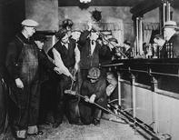 U.S. Prohibition agents destroy a bar in an undated photo held by the National Archives and Records Administration. REUTERS/U.S. Information Agency/NARAE/Handout via Reuters