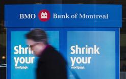 A man walks by a Bank of Montreal sign in Toronto, March 5, 2013. REUTERS/Mark Blinch
