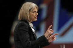 Britain's Home Secretary Theresa May gestures during her keynote address on the second day of the Conservative party annual conference in Manchester, northern England September 30, 2013. REUTERS/Phil Noble