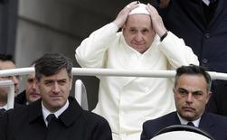 Pope Francis arrives to conduct his weekly general audience at St. Peter's Square at the Vatican November 27, 2013. REUTERS/Max Rossi
