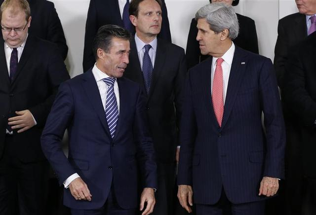 NATO Secretary General Anders Fogh Rasmussen and U.S. Secretary of State John Kerry (R) pose for a family photo during a NATO foreign ministers meeting at the Alliance headquarters in Brussels December 3, 2013. REUTERS/Francois Lenoir