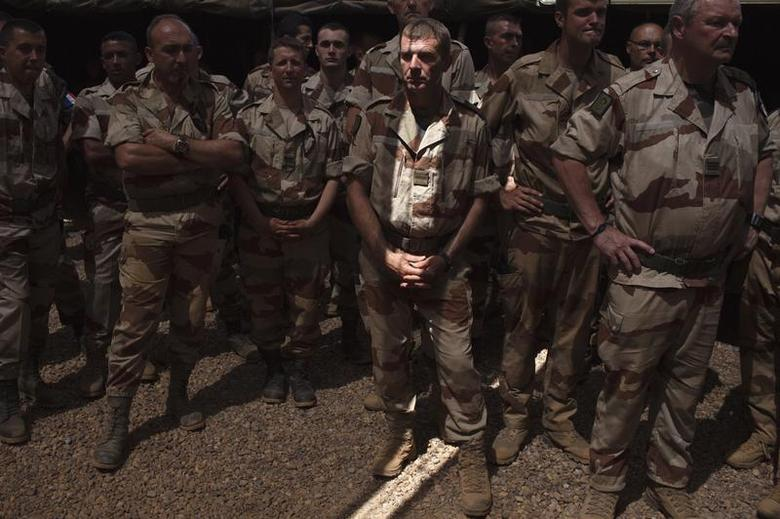 French soldiers wait for France's Defence Minister Jean-Yves Le Drian to arrive at a French military encampment at a Malian air base in Gao in this March 7, 2013 file photo. REUTERS/Joe Penney/Files