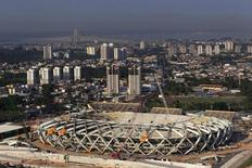 A view is seen of the ongoing construction of the Arena da Amazonas Stadium, with the Amazon River in the background in Manaus, October 7, 2013. REUTERS/Bruno Kelly