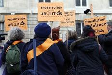 People attend a demonstration to abolish prostitution in France in front the National Assembly in Paris November 29, 2013. REUTERS/Charles Platiau