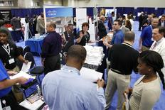 Jobseekers talk with recruiters at a Hire Our Heroes job fair targeting unemployed military veterans and sponsored by the Cable Show, a cable television industry trade show in Washington, June 11, 2013. REUTERS/Jonathan Ernst