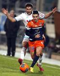 Montpellier's Remy Cabella (R) challenges Olympique Marseille's Andre-Pierre Gignac during their French Ligue 1 soccer match at the Velodrome stadium in Marseille, November 29, 2013. REUTERS/Jean-Paul Pelissier