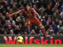 Liverpool's Luis Suarez takes a shot on goal against Norwich City during their English Premier League soccer match at Anfield in Liverpool, northern England, December 4, 2013. REUTERS/Phil Noble