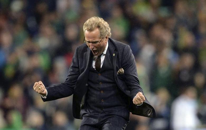 Sweden's coach Erik Hamren celebrates after his side beat Ireland during their World Cup qualifying soccer match at The Aviva Stadium in Dublin, September 6, 2013. REUTERS/Nigel Roddis
