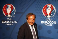 Michel Platini, UEFA President walks in front of the UEFA EURO 2016 logo at a news conference in Paris June 26, 2013. REUTERS/Charles Platiau