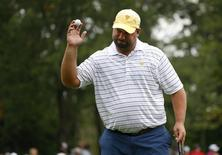 International team member Brendon de Jonge of Zimbabwe reacts after making his putt on the sixth hole while playing with teammate Ernie Els of South Africa against Phil Mickelson and Keegan Bradley of the U.S. in their Four-ball match at the 2013 Presidents Cup golf tournament at Muirfield Village Golf Club in Dublin, Ohio October 5, 2013. REUTERS/Chris Keane