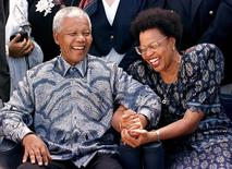 South African President Nelson Mandela (L) and his companion Graca Machel share a light moment before setting sail on board the QE II cruise ship in Durban harbour in this March 29, 1998 file photo. REUTERS/Mike Hutchings/Files