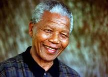 South Africa's President Nelson Mandela is seen in this August 1996 file photo. REUTERS/Mike Hutchings/Files