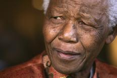 Former South African President Nelson Mandela smiles as he formally announces his retirement from public life at his foundation's offices in Johannesburg in this June 1, 2004 file photo. REUTERS/Mike Hutchings/Files