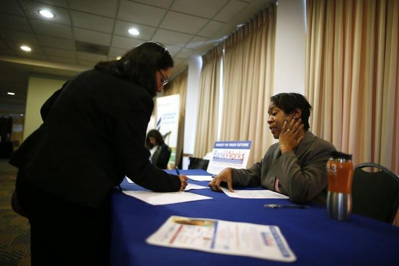Alese Pedro, from JVS-BankWorks (R), talks to job seeker Gloria Cuellar, 38, at a job fair in Los Angeles, California, November 18, 2013. REUTERS/Lucy Nicholson