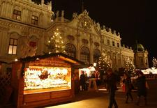 Belvedere palace is pictured behind an advent market in Vienna November 25, 2013. REUTERS/Heinz-Peter Bader