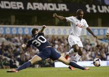 Tottenham Hotspur's Jermain Defoe (R) goes past Dinamo Tbilisi's Giorgi Gvelesiani during their Europa League soccer match at White Hart Lane in London August 29, 2013. REUTERS/Dylan Martinez
