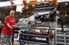 A Chrysler Group LLC employee works on the assembly line during the production launch of Chrysler vehicles at the assembly plant in Brampton January 7, 2011. REUTERS/Mike Cassese