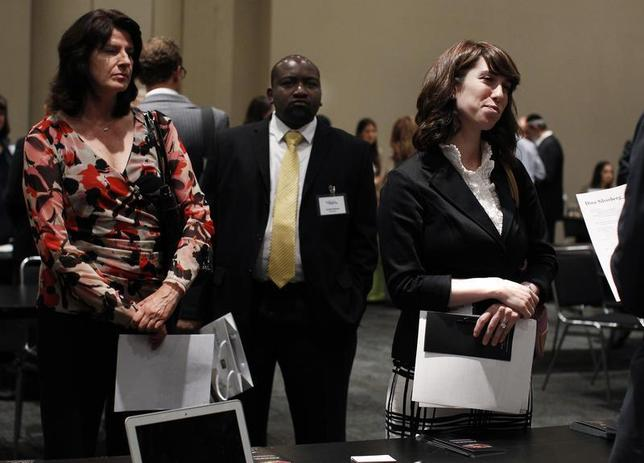A woman speaks with a recruiter from a jewelry and gem company as others wait during the Gemological Institute Of America (GIA)'s Jewelry Career Fair in New York July 30, 2012. REUTERS/Shannon Stapleton