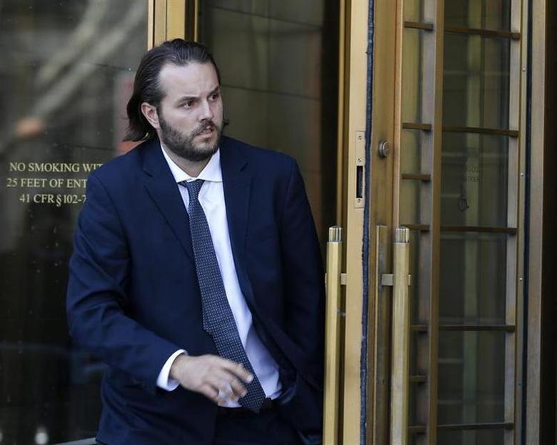 Former Goldman Sachs trader Matthew Taylor departs Manhattan Federal Court in New York, April 3, 2013. REUTERS/Brendan McDermid