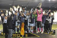 Dec 7, 2013; Kansas City, KS, USA; Sporting KC goalkeeper Jimmy Nielsen (1) raises the MLS Cup with his team after the 2013 MLS Cup against the Real Salt Lake at Sporting Park. Sporting KC won in a shootout. Mandatory Credit: Peter G. Aiken-USA TODAY Sports