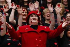 Singer Susan Boyle smiles as poppy's fall over her at a photocall during the launch of the Poppy Scotland appeal in Glasgow, Scotland October 24, 2012. REUTERS/David Moir