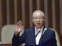 Nam Jae-joon, head of South Korea's state spy agency, the National Intelligence Service (NIS), swears in at a parliamentary investigative committee at parliament in Seoul in this August 5, 2013 file photo. REUTERS/Kim Hong-Ji/Files