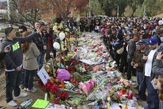 """Crowds gather at an unofficial memorial event for """"Fast & Furious"""" star Paul Walker in Santa Clarita, California December 8, 2013. Thousands of fans are visiting the area near the site where Walker and Roger Rodas died in a single-vehicle accident last weekend. REUTERS/Jonathan Alcorn"""