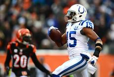 Dec 8, 2013; Cincinnati, OH, USA; Indianapolis Colts wide receiver LaVon Brazill (15) makes a catch and rushing into the end zone for a touchdown during the fourth quarter against the Cincinnati Bengals at Paul Brown Stadium. Mandatory Credit: Andrew Weber-USA TODAY Sports
