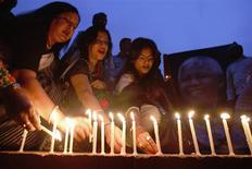Artists and activists attend a candlelight vigil in tribute of former South Africa President Nelson Mandela, in Dhaka December 9, 2013. REUTERS/Andrew Biraj