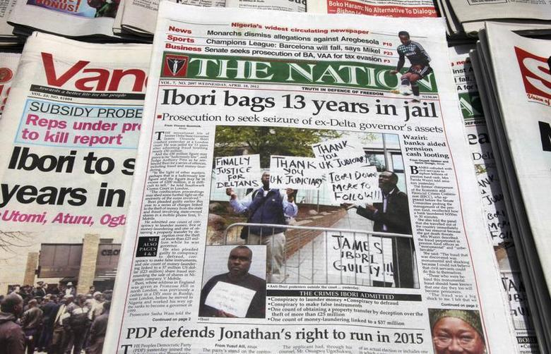 Newspapers, with details of the sentencing of James Ibori, are seen on a a news-stand in Lagos April 18, 2012. REUTERS/Akintunde Akinleye