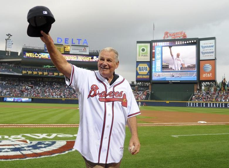 Former Atlanta Braves manager Bobby Cox waves to the crowd after throwing out the first pitch at the start of their home opening MLB National League baseball game against the Philadelphia Phillies in Atlanta, Georgia, April 8, 2011. REUTERS/Tami Chappell