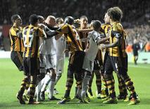 Swansea City and Hull City players scuffle during their English Premier League soccer match at the Liberty Stadium in Swansea, Wales, December 9, 2013. REUTERS/Rebecca Naden